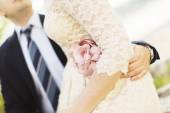 Young wedding couple holding each other — Stock Photo