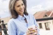 Beautiful girl drinking coffee in the morning on the terrace — Stock Photo