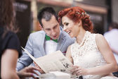 Wedding couple at the restaurant — Stock Photo