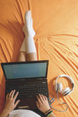 Top view of girl typing on lap top — Stock Photo