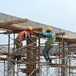 Construction workers dismantling beam formwork — Stock Photo #61452797