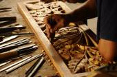 Skilled craftsman doing wood carving using traditional method — Stock Photo