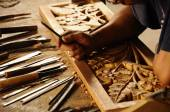 Skilled craftsman doing wood carving using traditional method — Foto Stock
