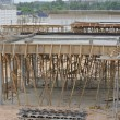 Timber beam formwork supported by row of scaffolding — Stock Photo #64349635