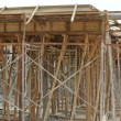 Timber beam formwork supported by row of scaffolding — Stock Photo #64349675