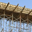 Timber beam formwork supported by row of scaffolding — Stock Photo #64349889