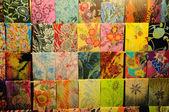 Colourful Malaysian Batik fabrics display at a market — Photo