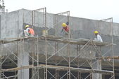 Plastering work by construction workers — Stock Photo