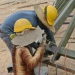 ������, ������: Construction workers welding metal