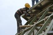 Construction workers grinding metal surface — Stock Photo
