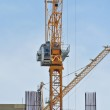 Tower Crane lifting heavy load — Stock Photo #64502175