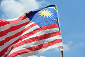 Malaysian flag in windy air — Stock Photo
