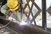Welders welded the decorative mild steel at the construction site — Stock Photo