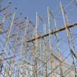Scaffoldings erected to support building formwork and also function as the platform for construction workers standing. — Stock Photo #72107547