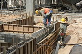 Two Construction Workers Installing Ground Beam Formwork — Stock Photo