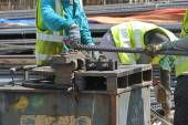 Construction workers bending the reinforcement bar at the bar bending yard in the construction site. — Stock Photo