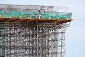 Scaffolding used to support a platform for construction workers to work — Stock Photo
