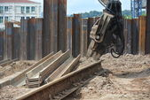 Retaining wall steel sheet pile installation by machine — Stock Photo