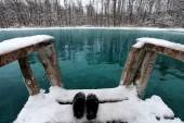 Winter swimming in blue lake — Stock Photo
