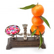 Tablets and fruits on scales — Stock Photo #80321720