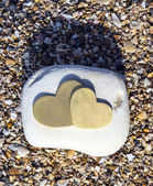 Two Hearts on a Bright Rock on Sand - Portrait — Foto Stock