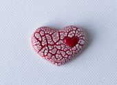 Red Crackled Heart on White Canvas — Stock Photo
