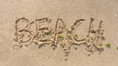 """Word """"Beach"""" Written In The Sand And Washed Away — Stock Video"""