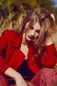 Girl in a red coat — Stockfoto