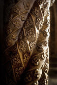 Detail of a carved column — Stock Photo
