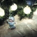 Little angel under Chrismas tree — Stock Photo #60781013