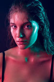Trend beauty at the studio model with wet face skin and hair shooting with the color filters — Stock Photo