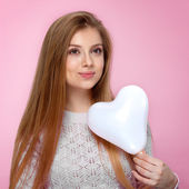 Sweet blonde woman holding a heartshaped baloon. Studio portrait over pink background. Happy birthday. Valentines Day. Joyful — Stock Photo