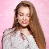 Sweet blonde woman smiling, winking. Valentines Day.  heartshaped bokeh background Joyful — Stock Photo