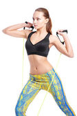 Sport female model training with inventory in a fashion sportwear. Studio shooting. — Stock Photo