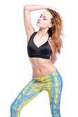 Sport female model training in a fashion sportwear. Studio shooting. — Stock Photo