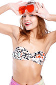 Bright sunny model is a swimwear and sunglasses. White studio shooting — Stock Photo