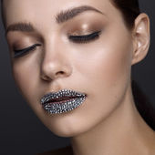 Luxury woman with rhinestones on her lips and closed eyes — Stock Photo