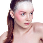 Young female model with unusual birdy make up in pink and white. — Stock Photo