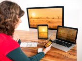 Woman with networked computer and mobile devices — Stock Photo