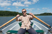 Man in the rowboat — Stock Photo