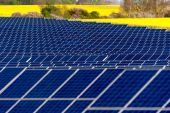 Solar panels in a rapeseed field — Stock Photo