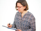 Woman with writing pad — Photo