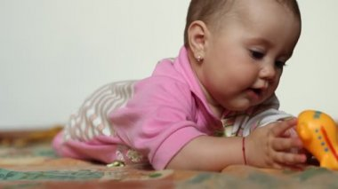 Baby Girl Playing with Toy — Stock Video