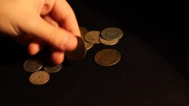 Collector Examines Old Coins — Stock Video