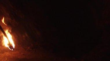 Explorer Illuminates his Way — Stock Video