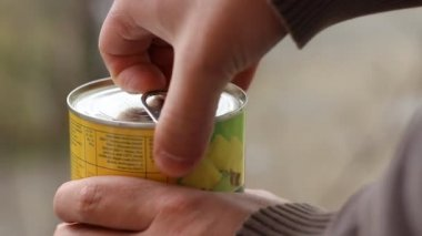 Man Opens Canned Food — Stock Video