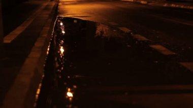 Man Walking on Rainy Night — Stock Video