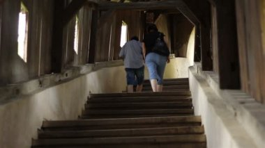 People Climbing Wooden Stairs — Stock Video