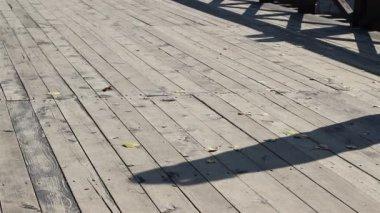 Man and Shaddow On Wood Bridge — Stock Video