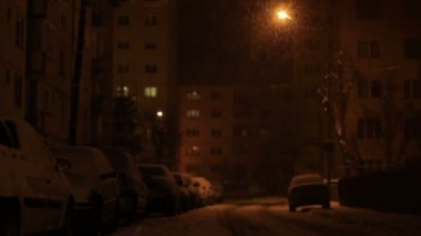 Nighttime Snowing on Cars and Street — Stock Video